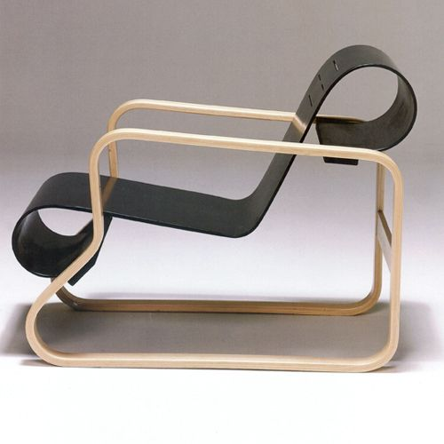 "Paimio ""Armchair 41"" Chair by Alvar Aalto, 1932. Frame in bent laminated beech with three solid wooden bars as stabilizers, seat in black lacquered molded plywood:"