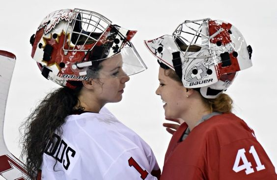 Shannon Szabados of Team Canada chats with Florence Schelling, Switzerland (Hockey Canada)