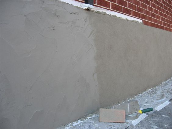 Parging Applying A Mortar Coat With A Trowel To Control Leakage In Masonry Walls Usually Exposed Basement Or Founda Masonry Wall Exterior Decor Stucco Walls