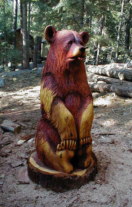 Sitting redwood bear web g chainsaw carving