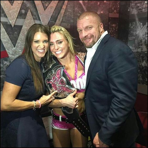 Charlotte, Steph, and Triple H