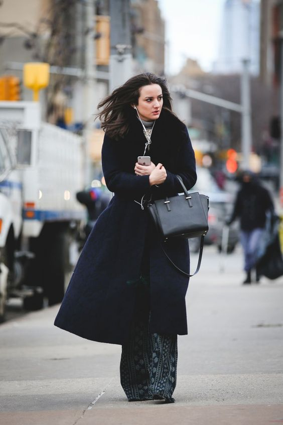 The longline coat, extra-long trousers pairing is the no-fail set of the season. #refinery29 http://www.refinery29.com/2016/02/103173/ny-fashion-week-fall-winter-2016-street-style-pictures#slide-4