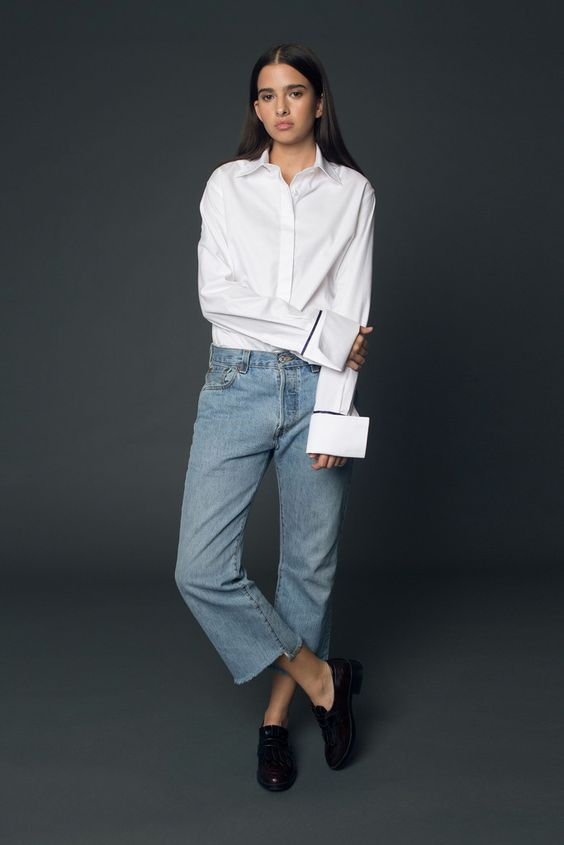 Anna Quan button front shirt in white twill. Slim button placket, overly-long sleeves and midnight blue silk trim on oversized cuffs. Made in Australia.: