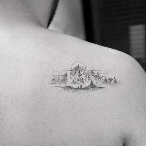 shoulder blade tattoo mountains