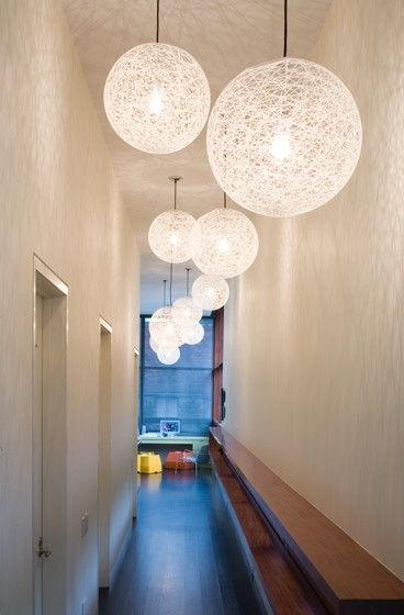 An example of unique lighting for long, narrow hallways. Fun idea!: