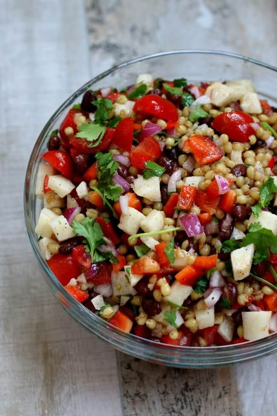 Make ahead healthy summer wheat berry salad recipe with avocados, black beans, jicama, red onion, cilantro, red peppers, grape tomatoes and lime dressing. Perfect recipe for potlucks, picnics and barbecues!