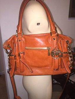 Check out Orange McGraw Large Cross body Tote on Threadflip!