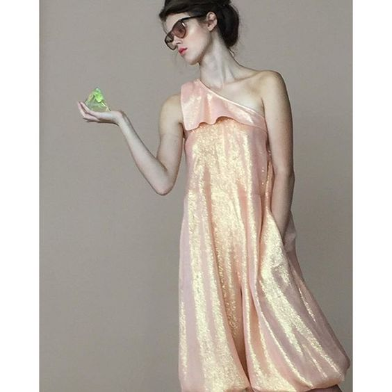 electricnest's photo on Instagram - Electric Feathers apricot iridescent spring summer vibes 2016 #ss16 ##apricot #sparkle #jumpsuit #lamé #nyfw16 #electricfeathers #spring #dancer #gold #peach #apricot #2016collection #madeinnyc #madeinnewyork #hudsonstudios