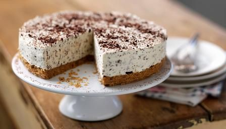 Irish cream liqueur gives this celebration #cheesecake the wow factor. Top with grated chocolate and a dusting of cocoa.