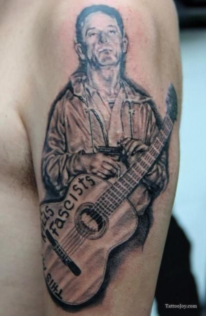 How was Woody Guthrie inspirational?