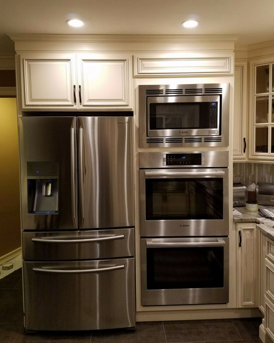 We love the challenge of making small kitchens look custom and high end. In this Bay Village home we created a custom Double Oven and Microwave combination cabinet for a client that loves to cook.