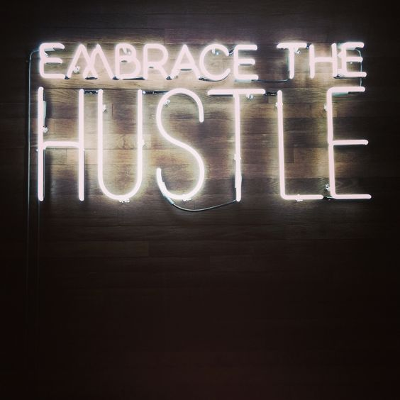 Embrace the Hustle! Neon sign at @wework Park South location