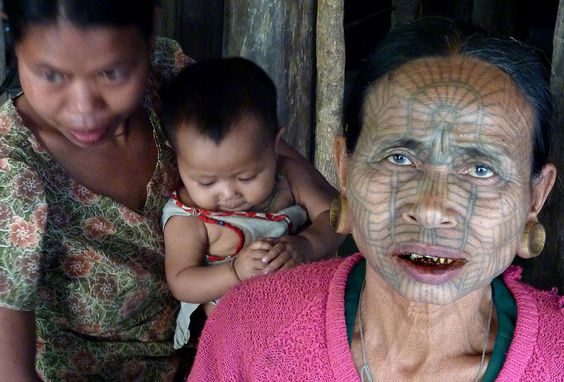 Chin woman, Panmaung Village, in Myanmar's remote northwest. Ma Htwe recalled the day of agony she suffered, more than five decades ago, when her face was etched with this intricate tattoo. With the practice ceasing two generations ago, Ma Htwe is now among a very few women left alive who bear the tattoos