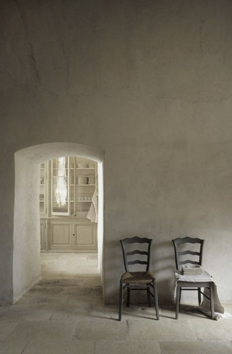 Pale stone in a European farmhouse with arched doorway and ethereal design. European Farmhouse and French Country Decorating Style Photos. #ethereal #stone #farmhouse #white