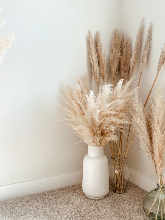 You can't go wrong with a big white vase and a bundle of pampas grass. It will look good in any setting!