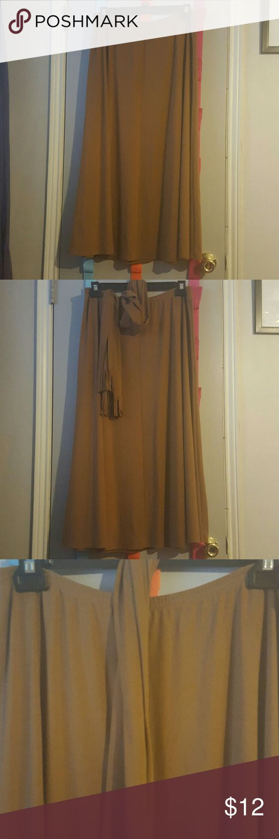 Khaki maxi skirt with sash belt Very cute never wore throw on some cowgirl boots and hat for fall or winter about 34 inches long with cute sash belt. Weekenders.com Skirts Maxi