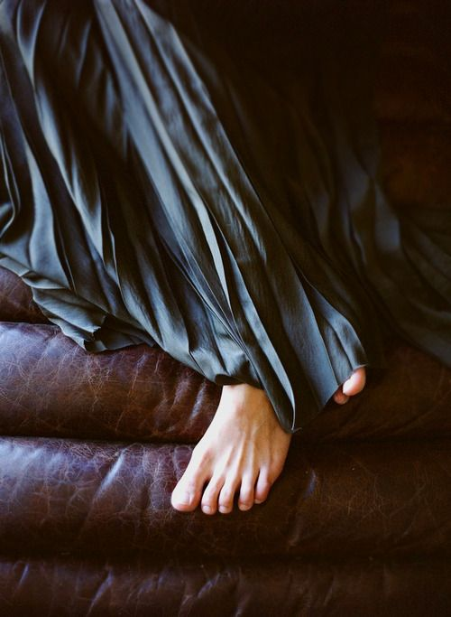 What a sumptuous photo....so intuitive and powerful....the flow of long skirt, the bare foot with toes so vulnerable....and crossed feet...this is awesome piece
