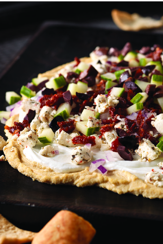 Mediterranean Tostada With Hummus, Feta, And Kalamata Olives Recipe ...