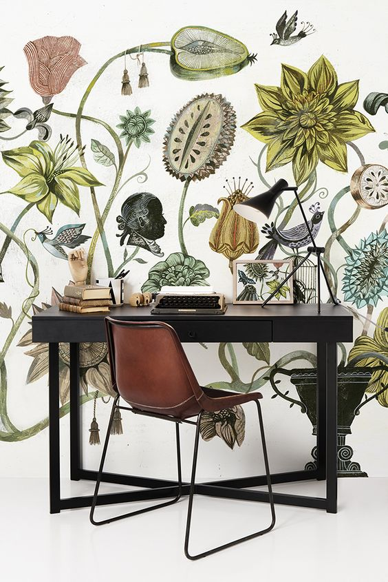 Botanical wallpaper and cognac colered leather chair: