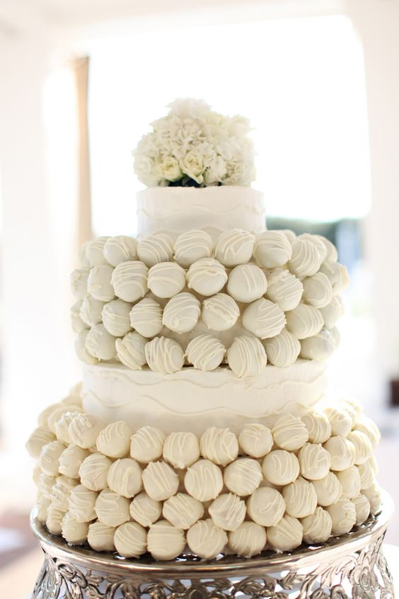 Cake-Pop-Wedding-Cake. LOVE THE IDEA OF CAKE POPS BUT ALSO A LITTLE BIT OF THE TRADITIONAL WEDDING CAKE.