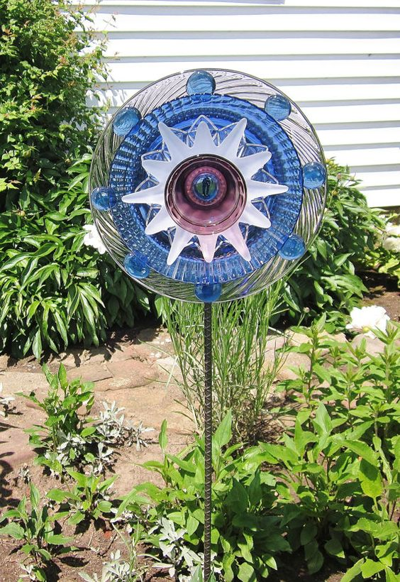 Gardens yard art and art on pinterest for Recycled glass garden ornaments