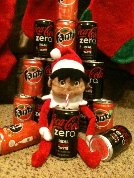 The elf brought back some elf-sized sodas from the North Pole to share -but he couldn't wait, he opened one first!