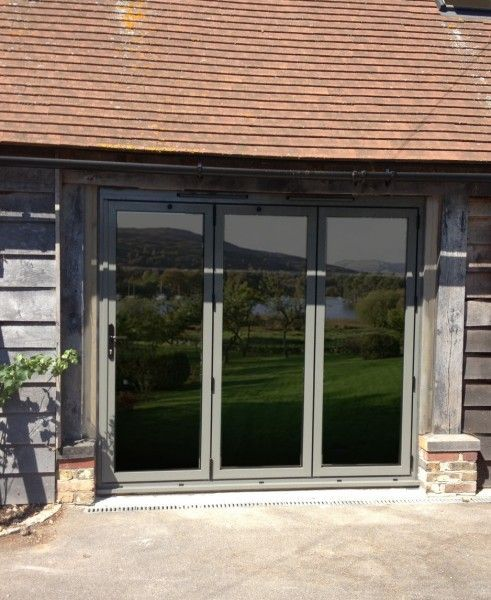 A Set Of Trifold Doors Incorporated In A Barn Conversion Barn Conversion Exterior Exterior Doors Barn Windows