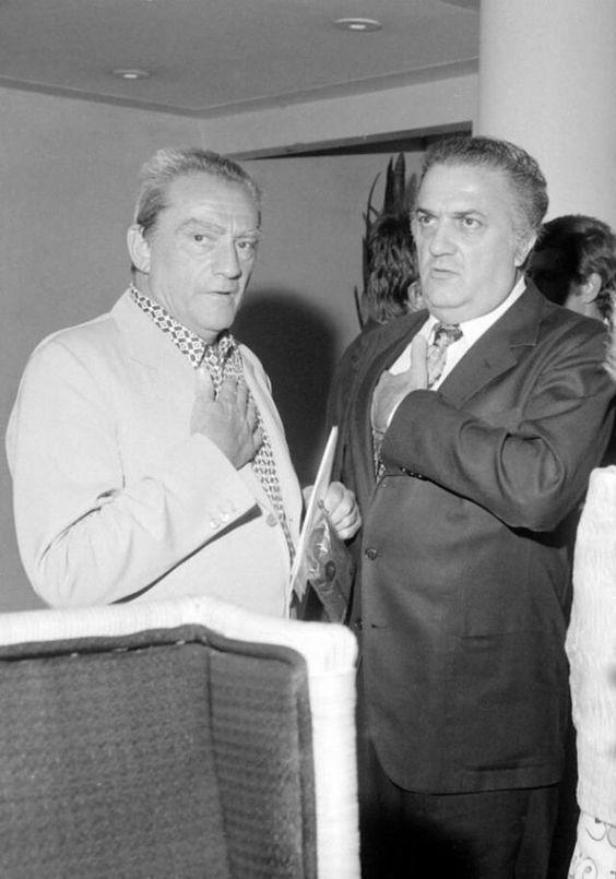 Luchino Visconti and Federico Fellini.