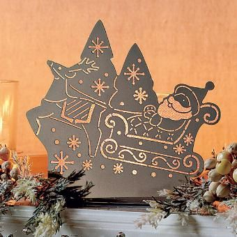 A sleighful of sparkle and shine! Santa boards his sleigh for a night of wonder and surprise. Photo-etched metal with glass votive cup to ho...