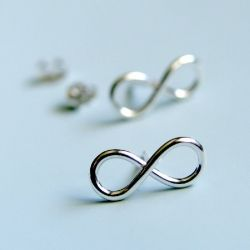 Rings and earrings from Luttrell Studio are clean, crisp and simple.