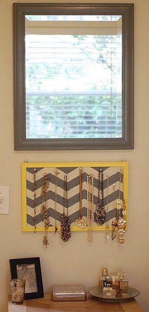 diy jewelry holder -- cork board behind my black/buralp chevron fabric, cheap black frame, and thumb pins