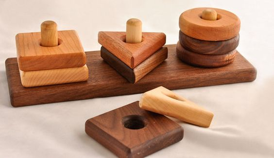 """This toy generously measures 12"""" x 4"""" x 3 1/2"""".  It is hand-crafted in my shop, out of quality hardwoods, sanded to smoothness, and finished with a natural, beeswax wood finish.  This listing is for a stacker with a walnut base and shapes made out of a variety of hardwoods (walnut, cherry, maple, mahogany).  We also offer stackers with cherry and maple bases."""