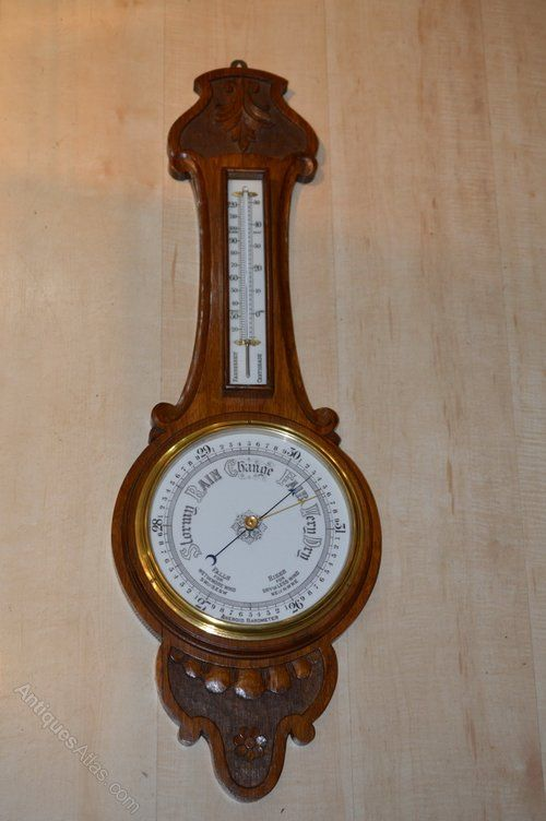 A Victorian Carved Aneroid Barometer
