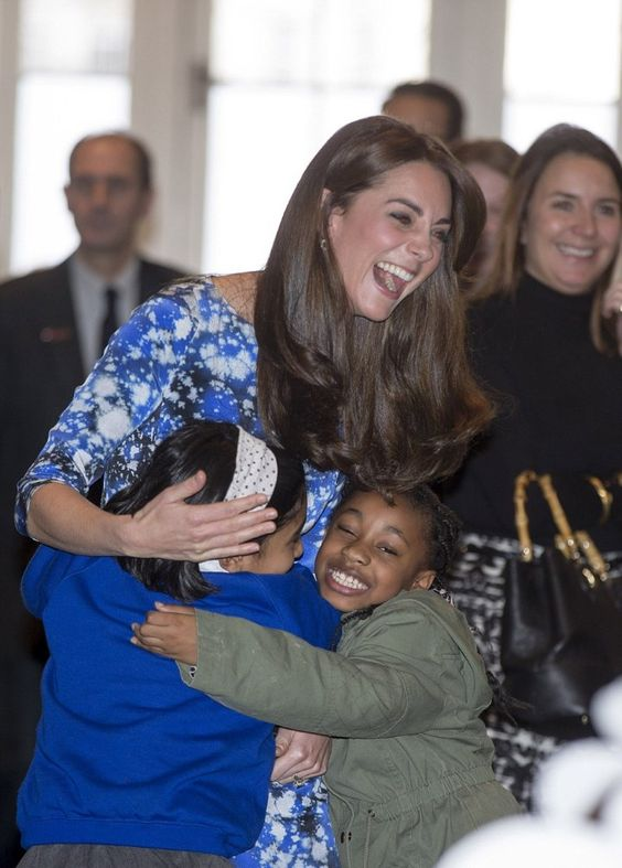 duchesskate: Charities Forum at BAFTA In-House Theatre, October 26, 2015-The Duchess of Cambridge gets a hug from children at the craft session