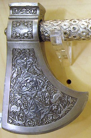 Indian tabar-zin (saddle axe), Lucknow, 18th century, chiselled steel head, ebony shaft covered with chased silver.