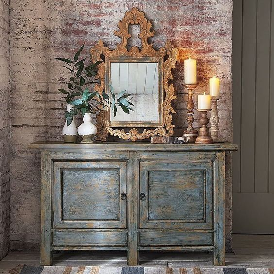 Friday evening feels, courtesy of our gorgeous Ornate Carved Wood Mirror and Molucca Media Console 🕯💖✨ #mypotterybarn #friday #friyay #homedecor