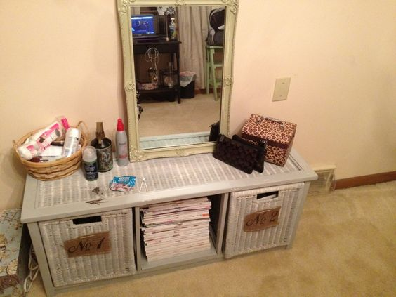 My temporary vanity made with an old wicker storage bench!