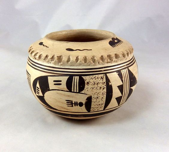 Small yellow ware Hopi pottery  bowl with an impressed shoulder is nicely painted by Nellie Nampeyo, 1896-1978,