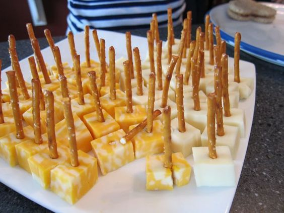 Cubed cheese using pretzel sticks instead of toothpicks.  Love this idea