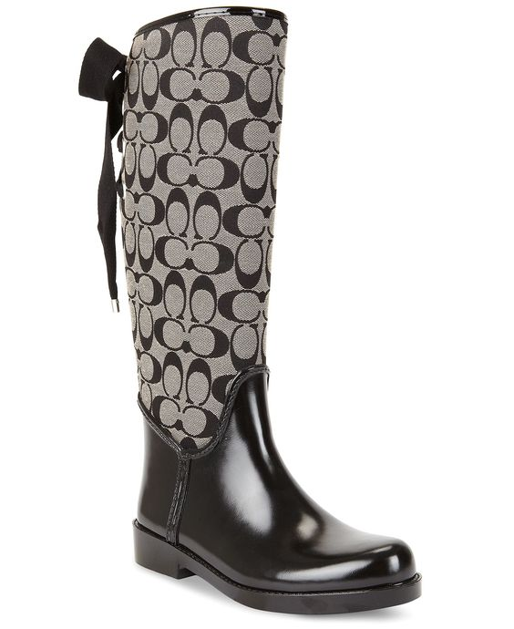 Coach Rain Boots with Signature C Logo and Bow on Back...UM YES PLEASE!!! Omg I just bought these ... and sweet Jesus they're beautiful!! They're sooo warm on the inside!!!! Never wanna take em off!