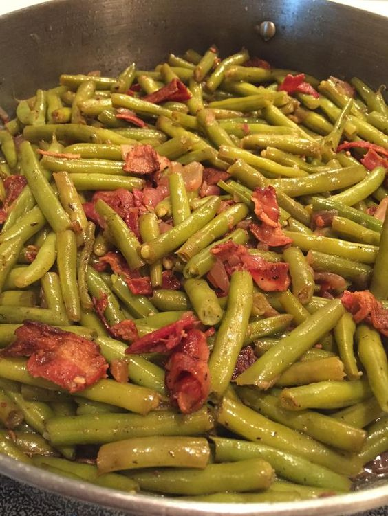 Southern Skillet Green Beans    I'm starting to see some really nice looking fresh green beans in the grocery store.... this recipe is so delicious...the beans are cooked with bacon, garlic and onions for a couple of hours, so they become so te...
