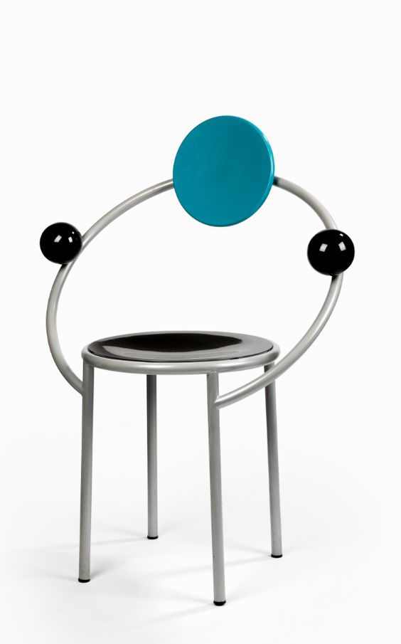 Michele de Lucchi (b.1951), 1983, Armchair 'First', Designed for Memphis, Herman Dommisse Collection, Amsterdam. This chair comes from the set of six, all unsigned, of which one was acquired by the Stedelijk Museum, Amsterdam. Silver lacquered steel and painted wood 80 by 69 by 50 cm.