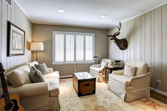8905 Croes. Cozy den could be the third bedroom  features gorgeous wood paneled walls, hardwood floors, recessed lighting and large windows overlooking the spacious backyard.  Bernstein Realty, Houston Real Estate
