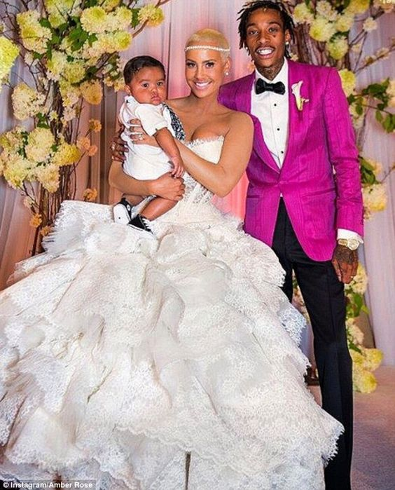 Finally: Amber Rose shared a wedding picture of herself with husband Wiz Khalifa and baby ...