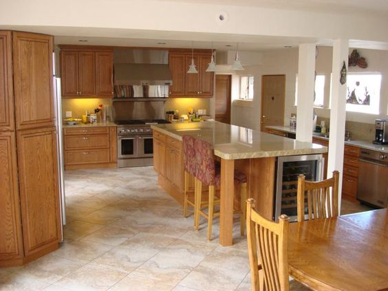 tiled floors with light oak cabinets | solid oak cabinets with granite counter tops throughout, tile floors ...