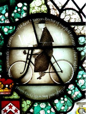 Stained glass roundal of the Canon Walter Herbert Marcon on his Bike in the church, Edgfield, Norfolk  (Image by Evelyn Simak)