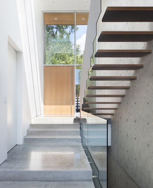 Russet Residence is a minimalist house located in Vancouver, Canada, designed by Splyce Design. Due to its proximity to the rugged and sloping creekside bank to the west, the house was subject to strict environmental and geotechnical conditions, including a required setback from the top of the bank that pushed the building's foundation eastwards. (14)
