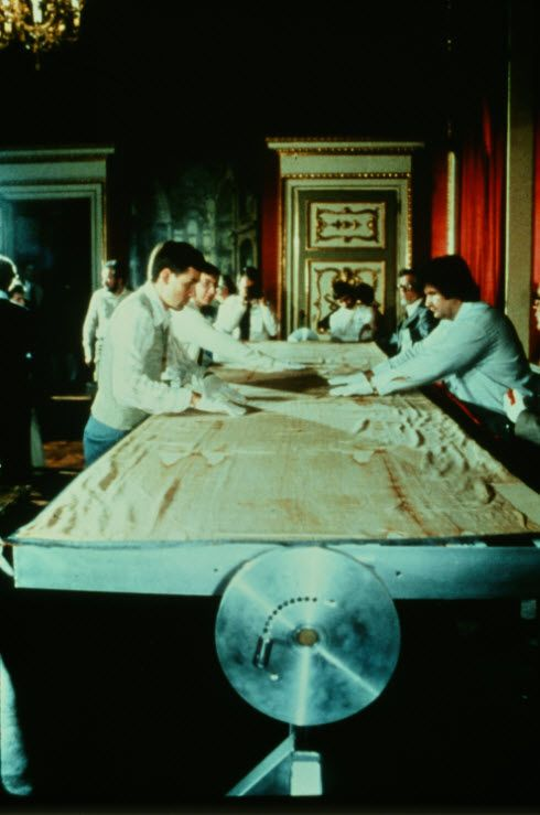 Photograph of American STURP scientists preparing to examine the Holy Shroud of Turin upon a table specially manufactured for that purpose.  Copyright Barrie Schwortz Collection, STERA, Inc.