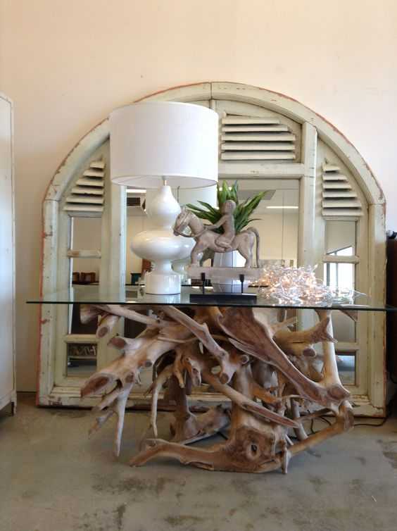 A large architectural salvage piece like this arched attic vent shutter turned into a mirror would make a great headboard