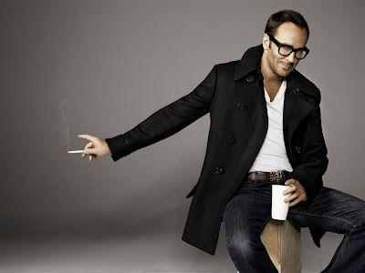 Tom Ford   - I think this is always the perfect guy uniform. Simple. Classic. Sexy. It's no wonder Tom Ford chose it for this photograph. It showcases his design esthetic perfectly. Relaxed. Timeless and always sophisticated.